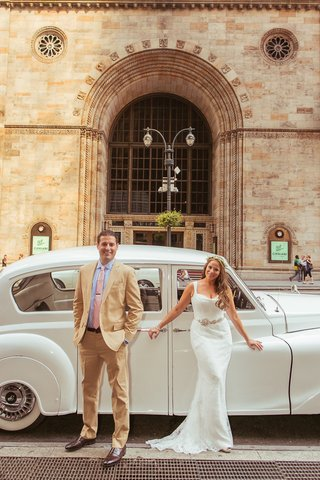 bride-and-groom-standing-in-front-of-white-rolls-royce-car