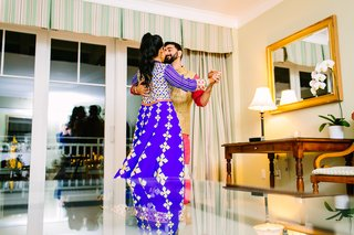 south-asian-couple-dances-in-hotel-room-at-sangeet