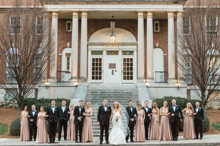 wedding-party-in-front-of-venue-with-bridesmaids-and-groomsmen