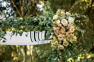 close-up-of-tallit-chuppah-jewish-wedding-ceremony-outdoor-greenery-pink-white-peach-roses-flowers