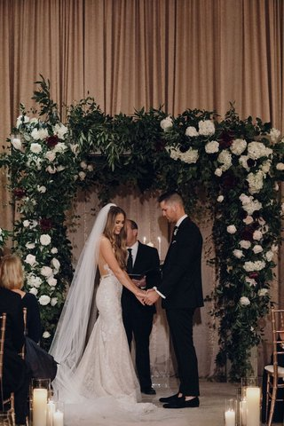 suzanna-villarreal-and-alex-wood-la-dodgers-wedding-ceremony-greenery-burgundy-white-flowers
