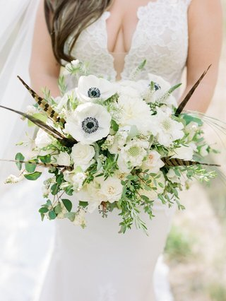 bouquet-with-anemone-flowers-feathers-white-flowers-and-greenery
