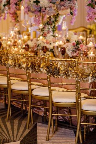wedding-reception-gold-chair-white-cushion-ruffle-chair-back