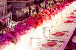 rectangular-table-decorated-with-lighted-box-with-ombre-pink-flowers-on-top