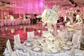 white-tables-and-chairs-with-pink-crystal-strands