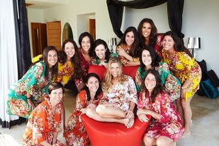 bridesmaids-and-bride-in-flower-print-short-robes-in-bridal-suite