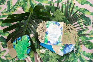 tropical-invitation-suite-with-blues-greens-and-golds-pineapple-insert-split-leaf-insert