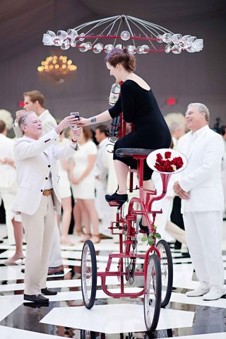 tall-red-tricycle-wedding-wine-server-at-reception
