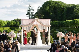 white-chuppah-with-garland-of-pink-and-white-flowers
