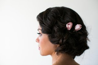 bridesmaid-with-loose-updo-and-pink-rosebud