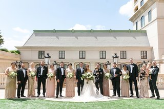 bride-in-stella-york-mismatched-bridesmaids-in-gold-and-champagne-hues-groomsmen-in-tuxedos