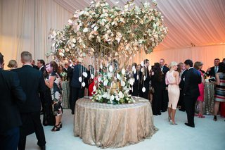 gold-tree-wedding-reception-escort-card-table-display-with-seating-assignments-hanging-from-chains