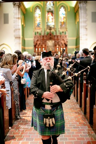 scottish-bagpiper-down-the-aisle-for-wedding-recessional
