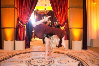 contortionist-in-maroon-pants-performs-at-entrance-of-moroccan-style-engagement-party