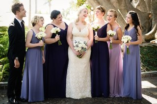 bride-in-willowby-by-watters-wedding-dress-bridesmaids-in-mismatched-alfred-angelo-purple-dresses