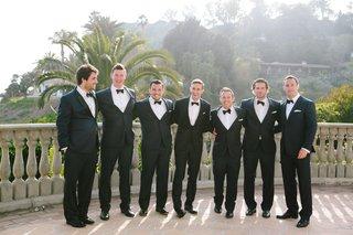 groom-in-custom-cad-and-dandy-suite-groomsmen-in-mr-tuxedo-bel-air-bay-club