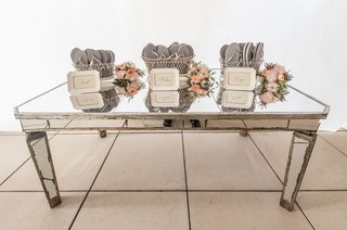 mirror-table-with-flip-flops-for-guests-before-dancing-at-the-reception