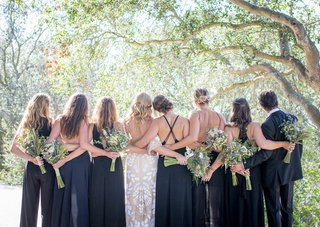 bride-bridesmaids-bridesman-male-bridesmaid-wildflower-bouquets-navy-blue-dresses-tuxedo-forest