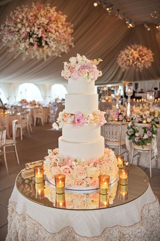 mirror-top-cake-table-with-five-layer-wedding-cake-with-fresh-flower-layers-in-between