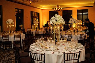 wedding-reception-with-white-flowers-and-linens-at-a-ballroom-in-bella-collina-montverde-fl