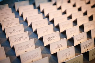 typed-escort-cards-purple-font-heart-motif-all-capital-letters-tent-style