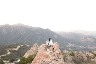 wedding-photo-bride-and-groom-on-rock-hill-mountain-overlooking-malibu-canyon-views-malibu-rocky-oak