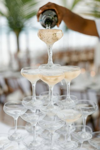 destination-wedding-in-the-bahamas-champagne-coupe-glass-tower-being-poured