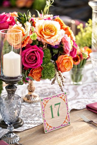 bohemian-wedding-reception-wood-table-with-table-number-pink-orange-green-purple-lace-runner