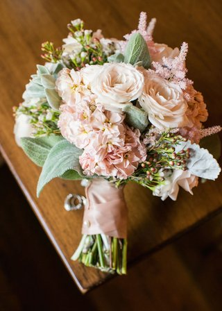 brides-bouquet-of-pale-pink-roses-astilbes-greenery-bound-by-pink-ribbon