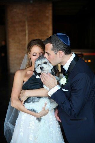 bride in strapless wedding dress flower applique groom in tuxedo with yarmulke little dog in tuxedo