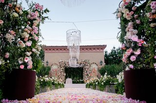 wedding-ceremony-at-grand-del-mar-with-flower-petal-aisle-rose-bushes-flower-wall-and-chuppah