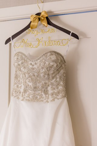 bridal-gown-with-beaded-bodice-on-personalized-hanger