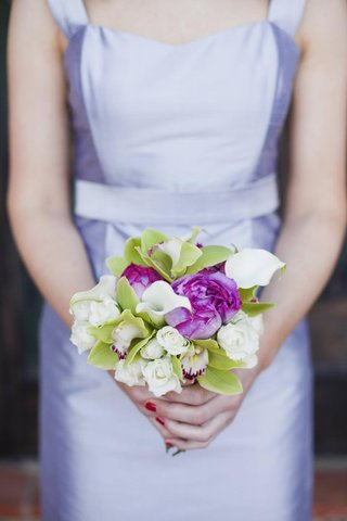 bridesmaid-holding-nosegay-of-flowers