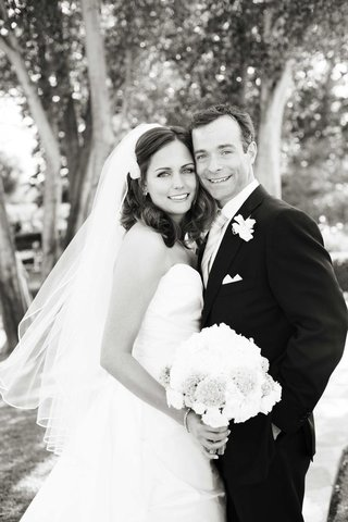 black-and-white-photo-of-newlyweds-on-wedding-day