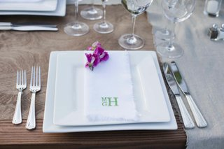 white-charger-plates-and-monogram-napkin