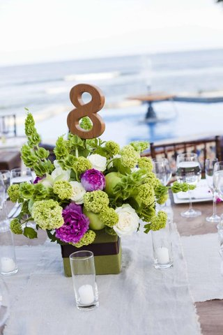 green-and-fuchsia-floral-centerpiece