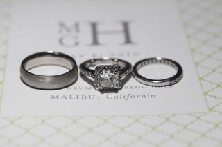 bride-and-grooms-engagement-ring-and-bands