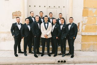wedding-party-groomsmen-in-alabaster-tuxedo-jacket-black-lapels-with-groomsmen-tuxedos-bow-ties