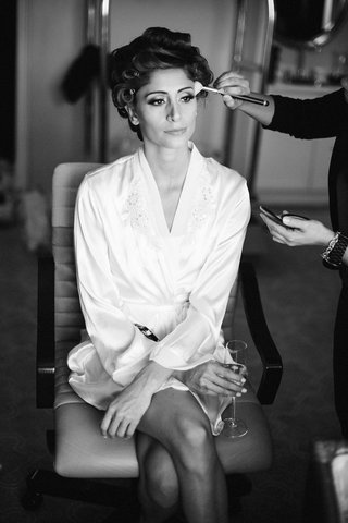 black-and-white-photo-of-woman-in-makeup-chair