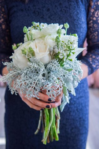bridesmaid-in-blue-lace-dress-holding-white-rose-bouquet