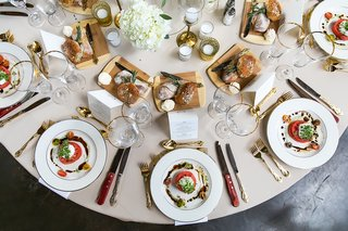 wedding-reception-tomato-and-burrata-salad-different-breads-and-butter-at-table