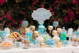 wedding-dessert-bar-with-gold-blue-and-green-featuring-cake-pops-cookies-blondies-and-candy