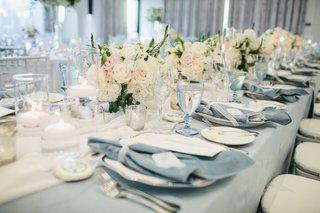 wedding-reception-long-table-low-centerpiece-blush-ivory-light-blue-linen-and-velvet-napkin-luxe