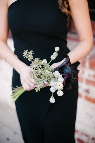 bridesmaid-in-black-dress-holding-midnight-calla-lily-and-weedy-bouquet
