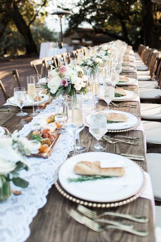 extended-wooden-tables-lace-runner-florals-simple-rustic-chic-wedding-reception-winery-bread