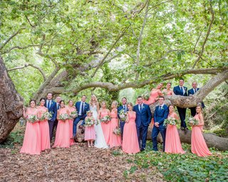 bridesmaids-in-coral-bridesmaid-dresses-groomsmen-in-bright-blue-suits-and-ties-wedding-california