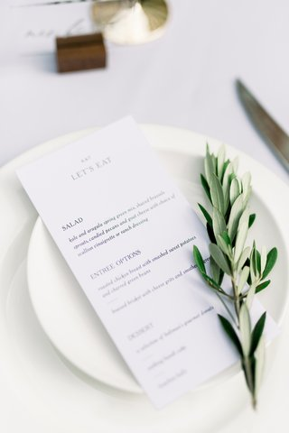 white-china-with-lets-eat-menu-and-olive-branch-on-top