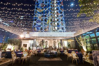wedding-reception-hotel-figueroa-outdoor-lounge-string-lights-mural-lounge-furniture-rentals