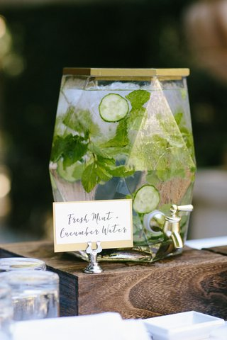wedding-ceremony-beverage-geometric-drink-dispenser-gold-top-cucumber-fresh-mint-water-infused