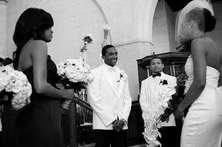 black-and-white-photo-of-jarett-dillard-at-wedding-altar